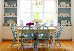 Love the white cabinets with the blue painted wall behind the white shelves.