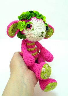 I love the colours in this crocheted toy - what a cute lamb.