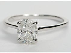 Petite Solitaire Engagement Ring in 18k White Gold, 1.08 ct center oval diamond