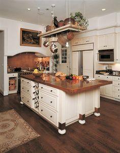 white cabinets, copper countertops