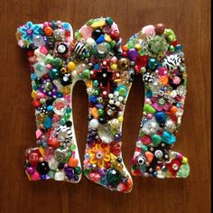 Bejeweled initial letter!!! Just glue any button, bead or little item onto initial.