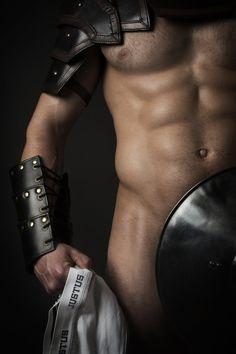 Male torso wearing gladiator attire