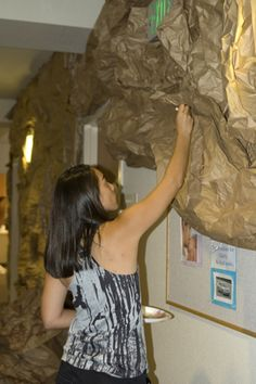 How to Make Rock Walls over existing interior walls with brown butcher paper, chicken wire and brown paint:  churcheventipedia.com
