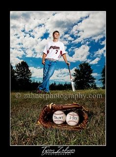 senior picture ideas - leaning on something with a football in the foreground?