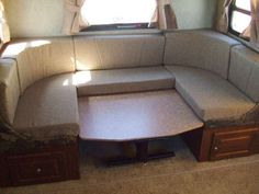 Large King size U shaped dinette in this Roo 23SS travel trailer camper.