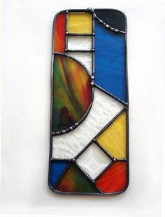 Abstract stained glass suncatcher contemporary modern colorful blue orange yellow window art via Etsy