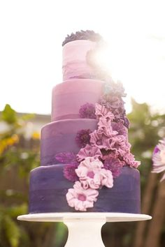 Over the top ombre wedding cake #desserts#ombre #weddingcake ombre, purpl ombr, shades of purple, color, wedding ideas, weddings, purple flowers, purple cakes, purple wedding cakes