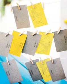 This couple wrote personalized notes on each grey and yellow escort card. See more of this dance-party wedding in Los Angeles on our website!