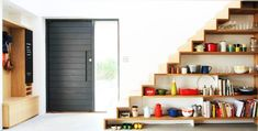 Maximize Your Interiors In Style With Under Stairs Storage Space And Shelf Ideas: Fashionable Shelves Under Stairs Showcase Well Defined Lines