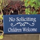 This is a site that sells a variety of them...    No Soliciting Children Welcome Door Wreath Wood Vinyl Sign