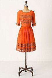 That beautiful orange.  I am not sure the line would work for my body, but I love the dress.  Anthropologie 2011.