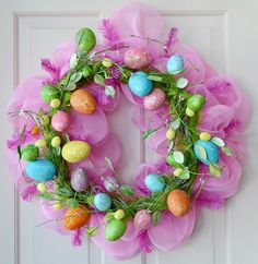 Glittered Easter egg wreath layered over a pink deco mesh wreath. So fun and festive for Easter!