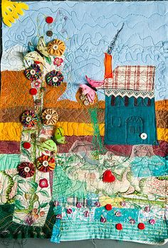 A fabric collage quilt with yo yos.