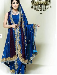 I would SO wear this! I am NOT from Pakistan, but I really like the colors, the pattern, and they flow of the dress. It looks very cool and comfortable. Pakistani Bride in Blue by Rizwan Moazzam