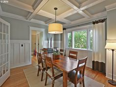A neutral color scheme makes this quaint dining room look sophisticated and inviting. The intricate wood paneling adds to the room's decor. The bright natural lighting makes the space appear large and open. Portland, OR Coldwell Banker SEAL $735,000 color scheme