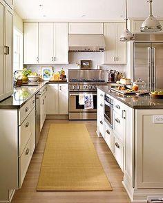 Ivory kitchen cabinets, white subway tile backsplash, black granite countertops.