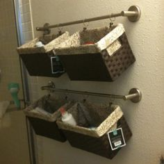 bathroom storage solution. Baskets and towel rods from Target.