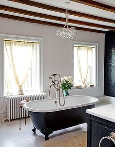 Awesome claw foot tub & chandelier.  Dream bathroom.