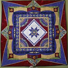 Pomegranate Star.  Round Robin quilt. Pretty awesome. Look at that angular border!