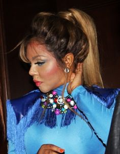 Lil Kims long, ponytail hairstyle