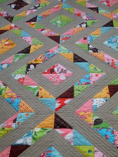 I like the colors.  Cabbage Quilts: The Wonderful Half Square Triangle Quilt