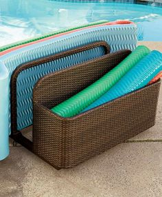 This summer, keep you pool floats organized in Frontgate's Wicker Float Storage.