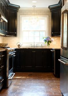 black kitchen cabinets white subway tiles