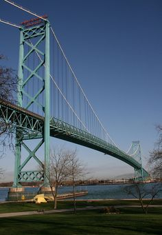 The Ambassador Bridge for those who aren't familiar with the Michigan area, connects Detroit, MI to Windsor, Ontario, Canada. The underwater tunnel is less than 2 miles east, down this Detroit River.