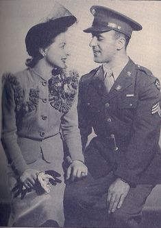 An American soldier says goodbye to his wife before heading off to WWII ~