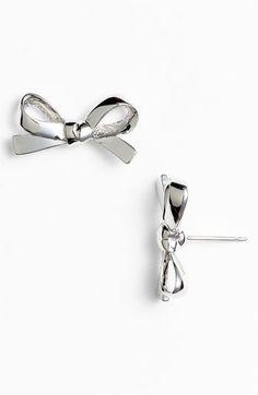 silver bow earrings.