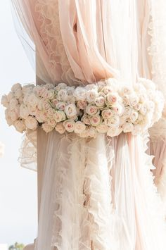 blush ruffled panels encircled in beautiful roses