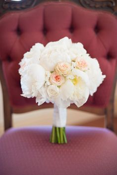 A soft, blush pink and ivory bridal bouquet.
