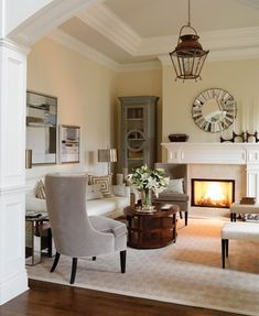 "color scheme: Warm browns and smoky greys make this high-ceilinged space seem more cosy.    Sarah decorated this ""Millionaire Designer Home"" for the VGH & UBC Hospital Foundation Lottery. ""I wanted it to have a coastal feel: a breezy, light-hearted tone that was sophisticated and elegant, too,"" she explains. Velvet-upholstered furniture and wood add a sumptuous note, while mirrors sparkle."