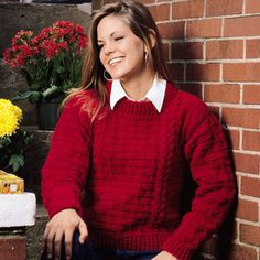 "Cheery Cherry Sweater - Crocheted in cheery red WW yarn, our cable-look pullover is bursting with fashion flavor! It's sure to be a cool weather wardrobe enhancer.   Finished Chest Measurements: Small - 35"", Medium - 40"", Large - 45"""