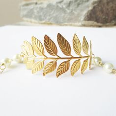 Hey, I found this really awesome Etsy listing at https://www.etsy.com/listing/113773211/gold-leaf-bangle-friendship-bracelet