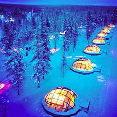 Kakslauttanen in Finnish Lapland, Finland  At Kakslauttanen you can stay in a snow igloo, a log cabin, or the coolest thing ever…a glass igloo! Lie in your bed with your loved one and watch the Northern Lights for a one-of-a-kind vacation.