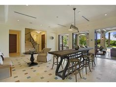 A long and narrow dining room table. Miami Beach, FL Coldwell Banker Residential Real Estate