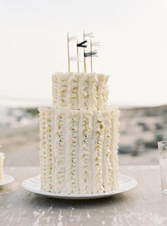 ruffled wedding cake by http://thescootabaker.com | Photography by josevillaphoto.com | Styling and Design by joydevivre.net |    Read more - http://www.stylemepretty.com/2013/07/18/nautical-wedding-inspiration-from-jose-villa-photography/