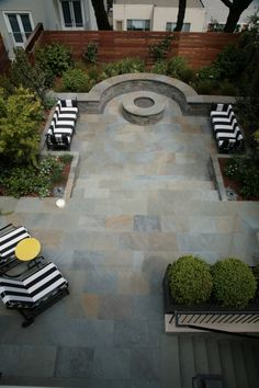 Landscaping with fireplace & seating wall