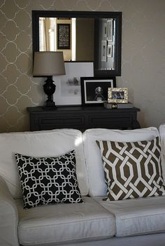 stenciled wall, table vignette behind sofa