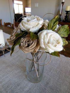 Burlap flower arrangement. Twigs for stems.