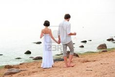 Young happy couple on the beach  Stock Photo