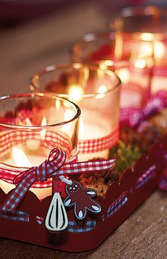 Red tray with clear votive holders tied with red checked ribbon, Christmas glow
