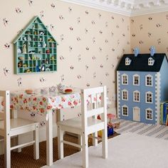 A sweet play area has been created in the home of Trine Miller by adding a mini gallery on top of a bathroom (click here to see the full room). The wallpaper is from Jane Churchill.  From the July 2009 issue of House & Garden