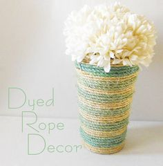 Dyed Rope Vase: Dye some rope with food coloring and wrap it around a container with a hot glue gun.   Source: Delightfully Noted