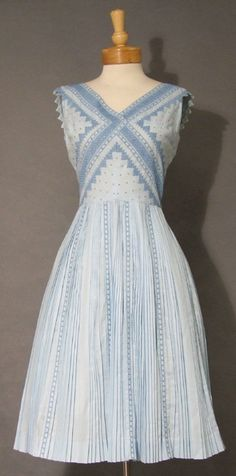 A great embroidered blue dress with especially nice detail on the sleeves