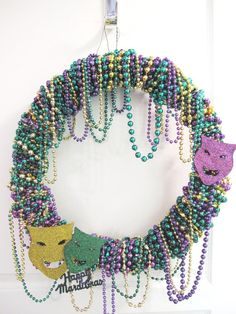 mardi gras wreath with authentic beads