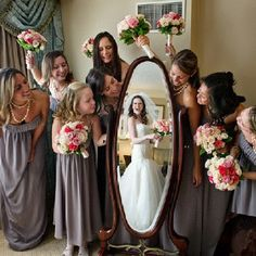 bridal party with the bride seen in the mirror, what a cool idea for a photo!