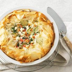 A flaky phyllo crust holds a delicious mix of sweet pepper, zucchini, spinach, garlic, and feta in this Greek Vegetable and Feta Cheese Pie. More casserole recipes: http://www.bhg.com/recipes/quick-easy/make-ahead-meals/healthy-casserole-recipes/ #myplate