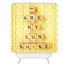 Sooo cute! Shower curtain with a typographic tile motif by Happee Monkey for DENY Designs.